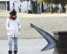 China's International Fund for Animal Welfare installed public exhibits featuring shark-sized coffins (with protruding fins) and small plaques nearby offering an explanation and asking visitors to sign a petition pledging to stop eating the animals.
