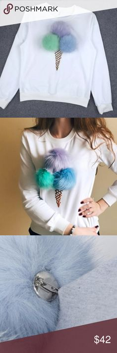Super fun chic shirt! Brand new amazing shirt. Removable Pom Pom.great quality. Tops
