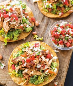 Chicken Tostadas with Avocado and Tangy Slaw | These tostadas get plenty of zip from a tangy slaw of shredded lettuce and carrots and richness from a smear of mashed avocado.