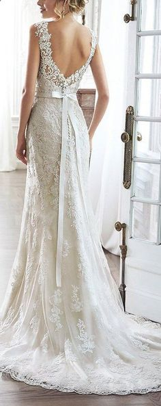 Cute Wedding Dress, the pinnacle of romance is found in this streamlined sheath rendered in exquisite lace. Complete with dramatic V-back beautifully detailed with illusion lace, sweetheart neckline and delicate cap sleeves. Finished with covered button over zipper and inner elastic closure and optional grosgrain ribbon belt with beaded motif. See at www.cutedresses.c...