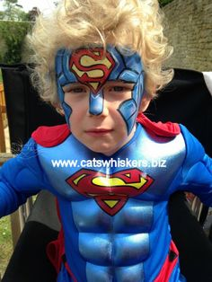 If Superman had worn a superhero helmet to work it would have looked something like this. Face painting by www.catswhiskers.biz