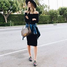 A denim jacket with a little black dress, wool fedora, and loafers.