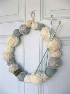 Do you have a passion for knitting? Why not use some of your leftover supplies to make a yarn-ball wreath. You will need a few balls of yarn, a wire coat hanger and a pair of knitting needles. Wreath Crafts, Yarn Crafts, Diy Crafts, Wreath Ideas, Diy Wreath, Knitted Christmas Decorations, Christmas Crafts, Christmas Ornaments, Xmas