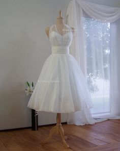 Really great dress. Could probably get the sash in black or purple to break up the white. Merilyn - Retro Inspired Tea Length Wedding Dress. Vintage Style Organza Bridal Gown.. $495.00, via Etsy.