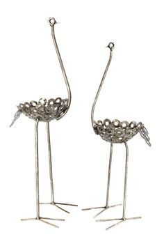 Swahili Small Recycled Metal Ostrich Planters Add whim to your outdoor setting with the small recycled metal ostrich planters. Handcrafted by Kenyan metal artists, these planters are made from recycle