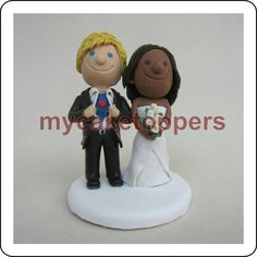 Check out this item in my Etsy shop https://www.etsy.com/listing/512833651/custom-wedding-cake-topper-bride-and