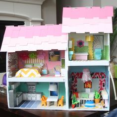 Handmade dollhouse made from cookware boxes.  Furnitures from toiletry boxes and egg cartons.  Decors made from cupcake liners, paint swatches and scrap fabrics.