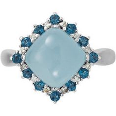 Milky aquamarine ring surrounded by London blue topaz and diamonds set in 14-karat white gold.