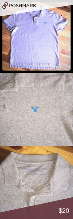 Like new American Eagle polo Like new condition American Eagle polo. It is a heather grey with bright blue eagle and trim around the sleeves. No rips, holes, or stains. American Eagle Outfitters Shirts Polos