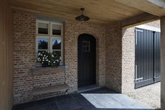 gorgeous grey exterior paint combined with red brick - Villabouw Vlassak Verhulst: