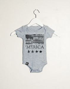 """Slyfox Threads """" 'Merica """" Onesie. Printed on a gray Onesie. Available In Sizes: 3-6 Mo., 6-12 Mo., 12-18 Mo., 18-24 Mo. *Please note that each shirt may have a different print size depending on the size of the shirt*"""