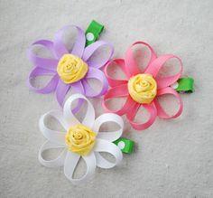 ribbon flower pic - I like the rose center I could make blue ribbon, 5 petal forget-me-nots for comfort shawls
