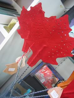 Textures:a combined effort of area artisansa.k.a. Textures Craftworks  -leather maple leaf fly swatter by Sharon Beasley - $18.95