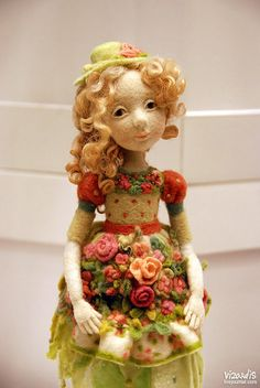 Spring personified...and absolutely gorgeous needle felt work! Needle felted Doll by Daria Koukouriba.