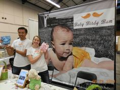 "Jefferson Dela Cruz + Jenny ""Mama Bird"" O'Neal holding their colorful CLOTH DIAPERS for the next generation. BABYBIRDYBUM.COM"