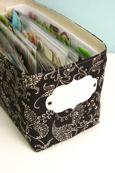 scrapbook storage-- slipcovered (whimsyshoppe.com) plastic container (container from Target) --