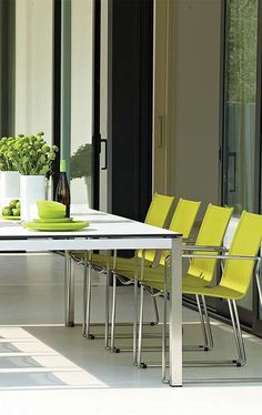 The Asta Collection by Gloster brings your outdoor dining space alive through clean, contemporary style and vibrant colored seats that make your collection complete and customizable.