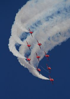 ˚The 9 BAe Hawk T.1s of the Royal Air Force Red Arrows display team in their trademark formation over Duxford during the 2014 Air Show - England