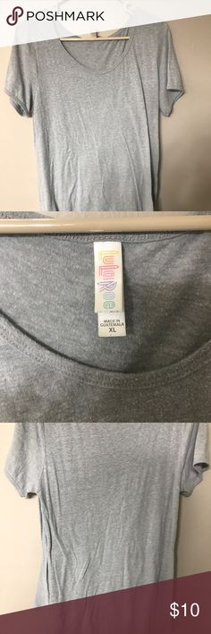 Lularoe classic tee XL Great condition! I can't remember the name of the shirt but it's either the classic tee or the perfect tee LuLaRoe Tops Tees - Short Sleeve