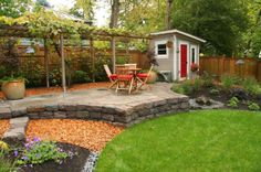 traditional landscape by Landscape East & West. Retaining wall and flagstone.