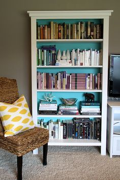hello, friday! and hello, friends!  i'm here to share possibly my favorite diy project from last year. okay, i  say that a lot, but this one really is a doozy. along with a much better  layout, this is the project that truly transformed our living room:  bookshelves we built ourselves!  our f