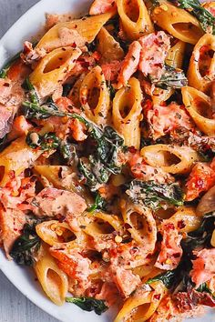 Salmon Pasta with Sun-Dried Tomato Cream Sauce and Spinach - quick and easy dinner made in 30 minutes! Pan-seared salmon is combined with the delicious penne in a flavorful, restaurant-quality cream sauce. Salmon is a Salmon Pasta Recipes, Creamy Salmon Pasta, Salmon Dishes, Seafood Recipes, Pasta With Salmon, Vegetable Pasta Recipes, Creamy Tomato Pasta, Vegetable Pizza, Salmon Seasoning