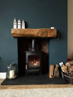 Fireplace Finished Charnwood C-Four Riven Such a cosy fireplace with a slate hearth, exposed brick & rustic oak beam. Love the dark blue wall and home accessories, too! Home Living Room, Interior, Living Room Decor, House Styles, Home Decor, House Interior, Cosy Fireplace, Slate Hearth, Interior Design
