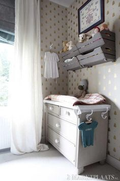 I like the hooks on the side of the changing table. *Also like the style of crates above the changing table. Would probably remove the bottom drawers and put blankets, sheets, etc in baskets. Girl Nursery, Girl Room, Nursery Decor, Nursery Storage, Toy Storage, Babies R, Baby Co, Baby Bedroom, Baby Kind