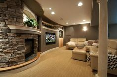 Contemporary Living Room with stone fireplace, Built-in bookshelf, Torino Collection 1-Light Brushed Nickel Wall Sconce