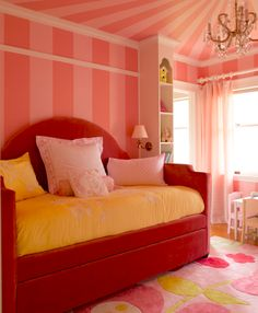 girl's bedroom with pink striped walls and upholstered daybed // design by Graciela Rutkowski #bedroom #pink #daybed