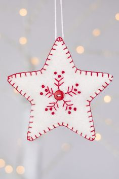 Red and white snowflake felt Christmas ornament set A set of two hand stitched felt ornaments, embroidered with a snowflake pattern in red and white and finished with blanket stitched edging and small buttons. Handmade Christmas Decorations, Felt Decorations, Beaded Christmas Ornaments, Snowflake Ornaments, Unicorn Christmas, Felt Ornaments Patterns, Fabric Ornaments, Diy Ornaments, Glass Ornaments