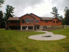 Seculded private lake home - fabulous landscaping includes this campfire - 5135 Torch Lake Rd, Conover, WI 54519