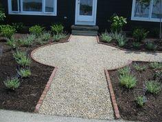 Pea Gravel walkway bordered with brick.