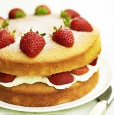 A victoria sponge cake topped with strawberries