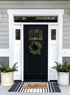 How perfect is this front porch? The contrast between the black front door and white trim is stunning! Front Door Trims, Front Door Porch, Front Door Entrance, Front Door Decor, Entrance Ideas, Black Exterior Doors, Black Garage Doors, Black Front Doors, Exterior Door Trim