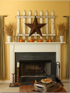 Fall mantle with picket fence, Broze Star, miniature pumpkins, neutral candles