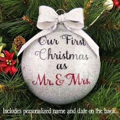 Personalized Our First Christmas Married Glitter Ornament by PenguinsPieces. All the sparkle and none of the mess! Glitter is on the inside and each one is personalized with your name and date on the back.