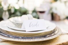 These place settings are on point with such romantic and effortless style. Silver table ornaments by @pettigrovelane sit perfectly next to lettering by @brahminletteringco. Photograph @katymelling