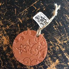 Embossed Circle Ornament Red Dirt by OklahomaRealRedDirt on Etsy