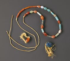 Middle Kingdom, Dynasty 12, reign of Amenemhat I | ca. 1975 B.C. |   Egyptian; From the tomb of Wah, western Thebes.  Carnelian and linen thread; blue-glazed steatite and linen thread; carnelian, turquoise, moss agate, amethyst, milky quartz, green-glazed steatite, and twisted linen cord