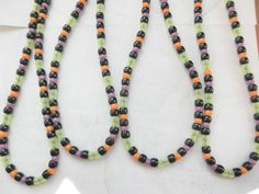 Halloween Party Favors Glow Bead Necklaces Set of 4. $14.00, via Etsy.
