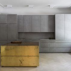 Kitchen in grey Valchromat, concrete and brass. Gold and grey apartment - Designed by Studio Richard Lindvall Brass Kitchen, Kitchen Decor, Kitchen Grey, Kitchen Island, Kitchen Dining, Kitchen Cabinets, Grey Kitchens, Cool Kitchens, Placard Design