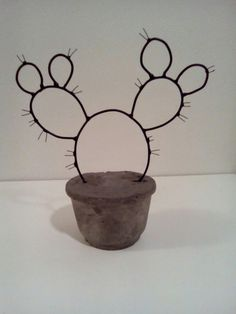 cute little wire cactus in concrete planter