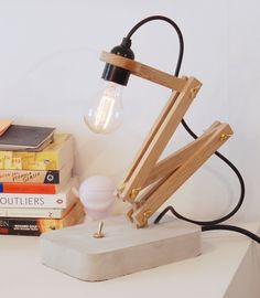 Wood Oak and Concrete Pliable Desk Lamp - Desk Lamps, Wood Lamps - A beautiful pliable wood oak table lamp with exposed light bulb. Made with Swedish oak tree and concrete with brass details. Looks best with an …    Read More »  #Desklamp #Edison #Handmadelighting #Lamp #Lightbulb #Lighting #Lightingdesign #Oak #Tablelamp #Woodlamp #Woodworking