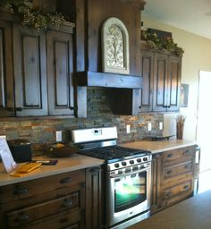 slate backsplash in brick pattern~~ I don't like the counter tops, but the rest of the kitchen is...oh me, oh my!