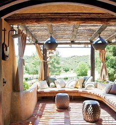 so nice - a comfy moroccan-inspired patio with an outdoor shower.