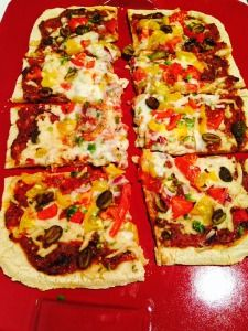 Mexican Pizza -  This quick, inexpensive and delicious personal-sized pizza recipe is a busy weeknight favorite. Divide this simple no roll, hand-pressed crust into two mini-sized, kid-pleasing pizzas. This crust costs under a quarter to make and assembles in less time than it takes to preheat the oven. Keep dinner quick and simple with two toppings or have a pizza fiesta with 10 toppings and all your friends.