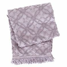"Curl up with your latest read and this lovely cotton throw, showcasing a textured geometric motif and fringed edge.    Product: Throw Construction Material: 100% Cotton  Color: Dusty iris  Features: Textured surfaceGeometric motifFringed edge Dimensions: 50"" x 70"""