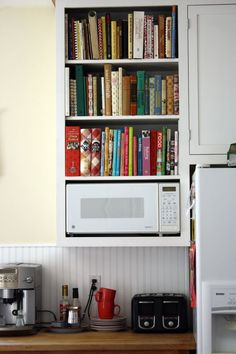 cookbooks and wooden bench top with white