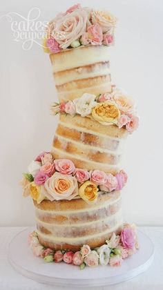 rustic naked topsy turvy wedding cake / http://www.deerpearlflowers.com/topsy-turvy-wedding-cake-ideas/